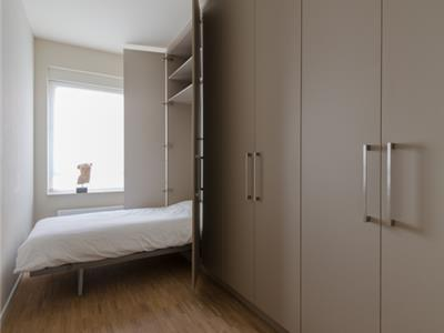 Dressing met bed in kast